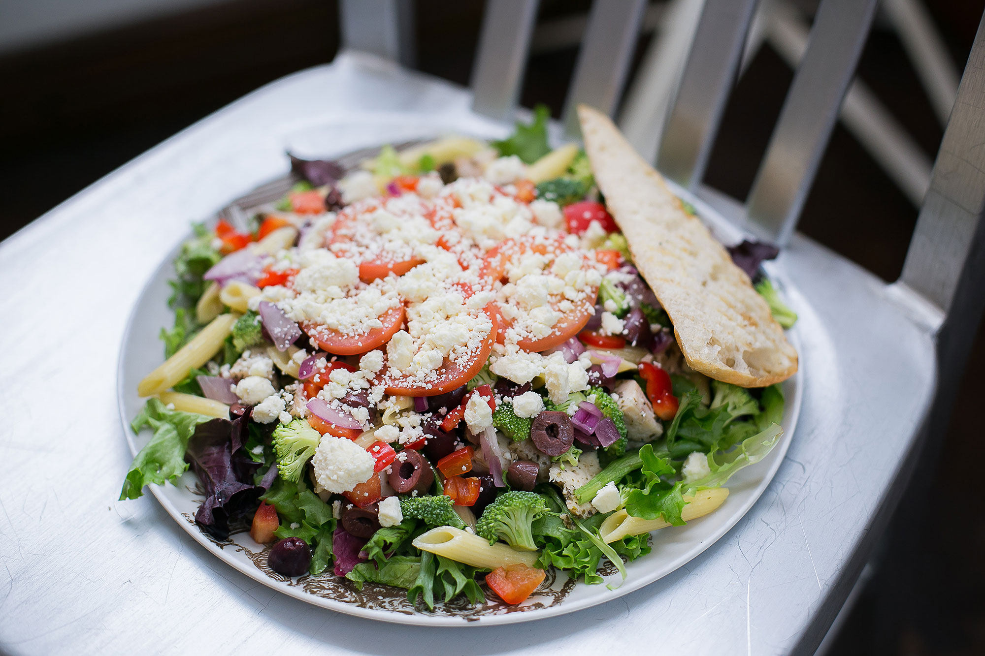 Seasoned chicken breast, tomatoes, red peppers, brocolli, red onions, penne pasta, kalamata olives, feta cheese, vinaigrette dressing